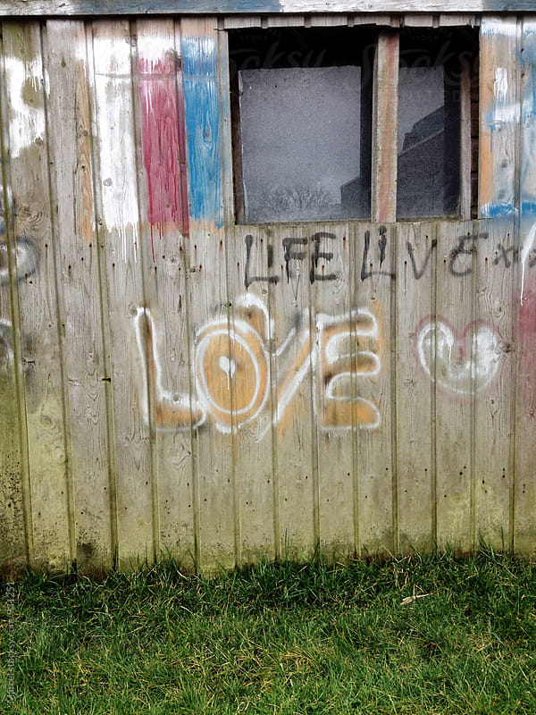 Lovely writing on the wall of a shed by Marcel for Stocksy United