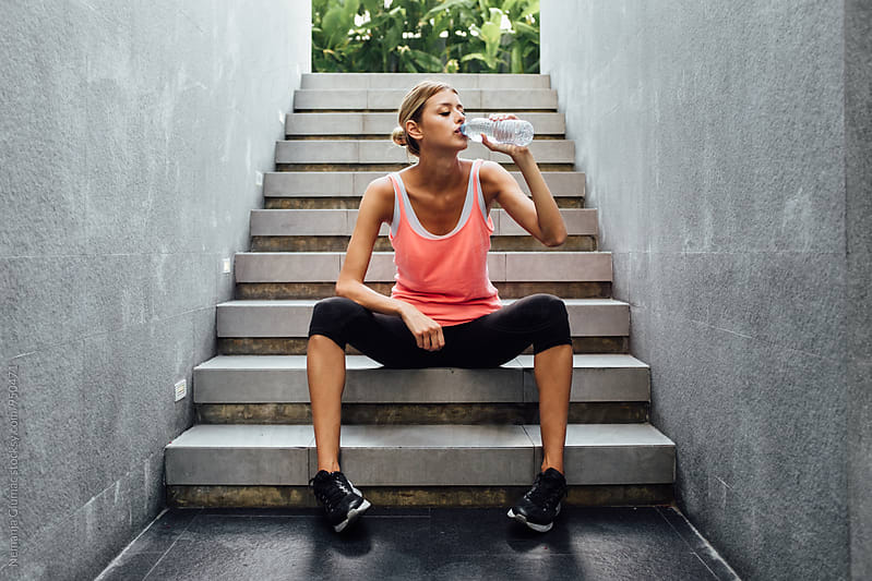 Woman Takes a Break After Workout by Nemanja Glumac for Stocksy United