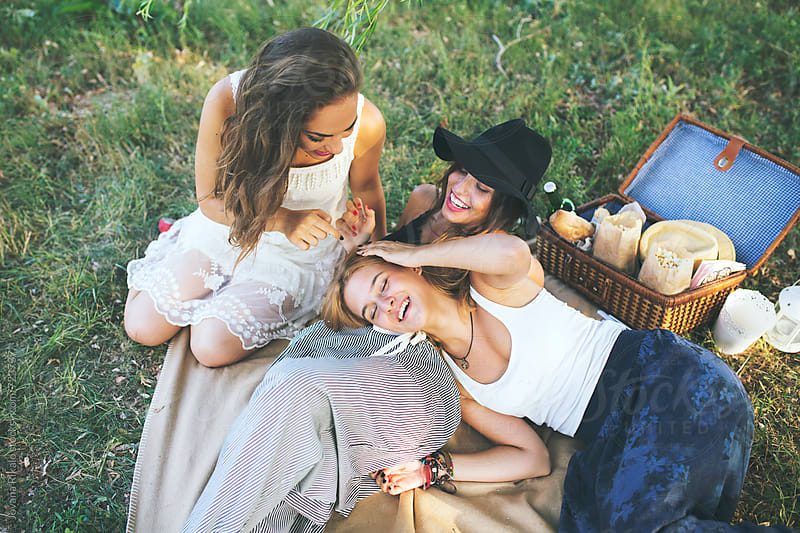 Group of happy female friends having fun outside in nature by Jovana Rikalo for Stocksy United