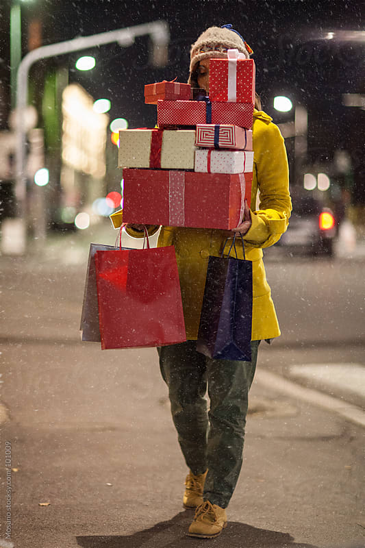 Carrying Christmas Gifts on a Snowy Night by Mosuno for Stocksy United