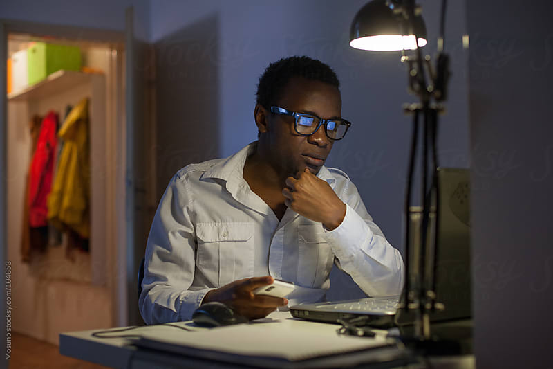 Businessman Working Late in His Home Office by Mosuno for Stocksy United