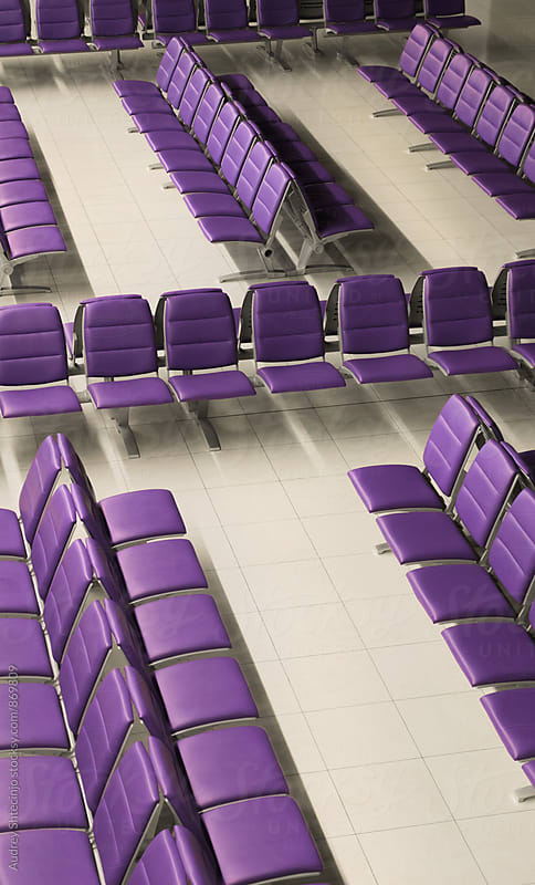 Empty purple chairs on airport by Marko Milanovic for Stocksy United