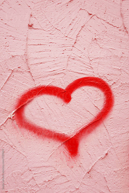 graffiti red heart on pink textured wall with copyspace by Sonja Lekovic for Stocksy United