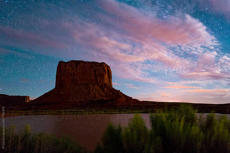 NIght Sky Over Mitchell Butte in Monument Valley Utah USA Lit By Moonlight by JP Danko for Stocksy United