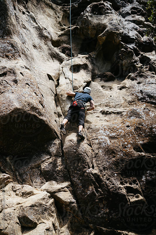 Climbing in Castle Rock by Ryan Tuttle for Stocksy United