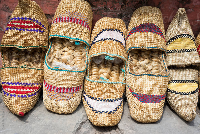 Traditional nepali straw sandals on the floor by Bisual Studio for Stocksy United