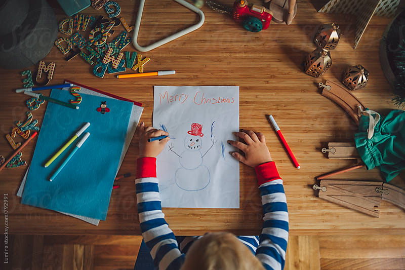 Boy Drawing a Snowman by Lumina for Stocksy United