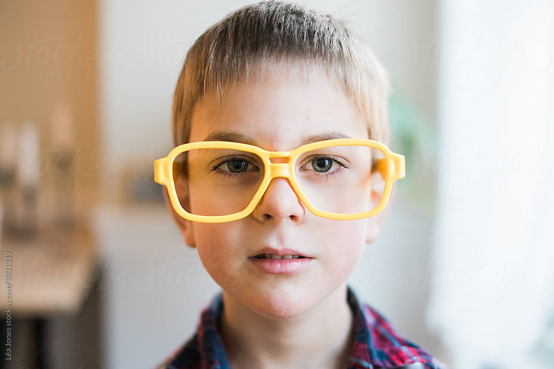 little boy with yellow plastic glasses by Léa Jones for Stocksy United