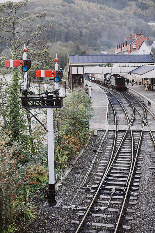 A traditional British train signal next to a railway station in Wales by Maresa Smith for Stocksy United