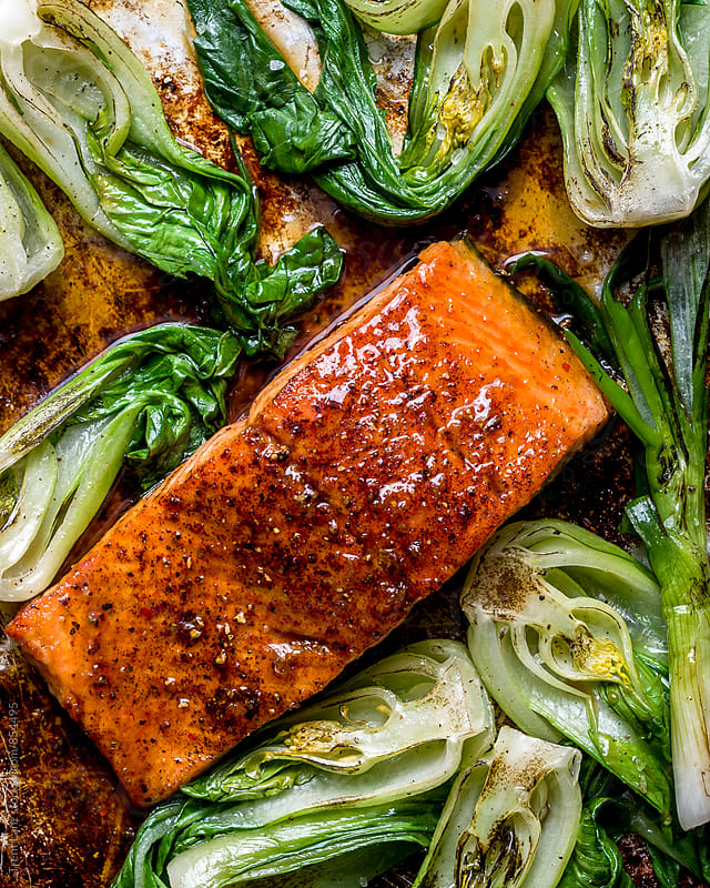 Close-up of maple soy salmon steak with onion by Trent Lanz for Stocksy United