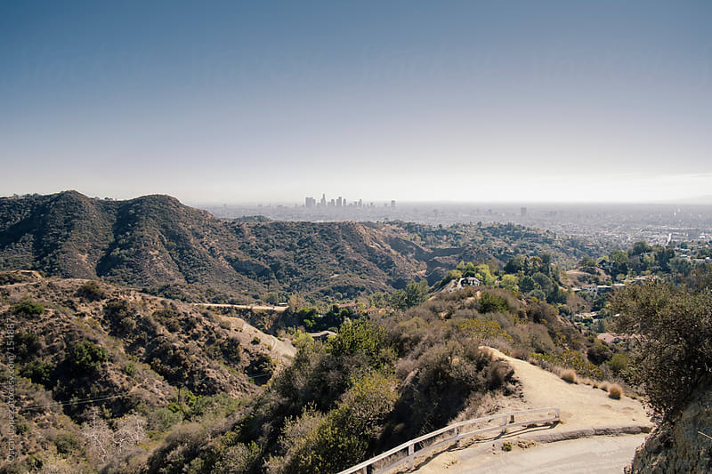 Downtown Los Angeles from the Hollywood sign by Oscar Lopez for Stocksy United