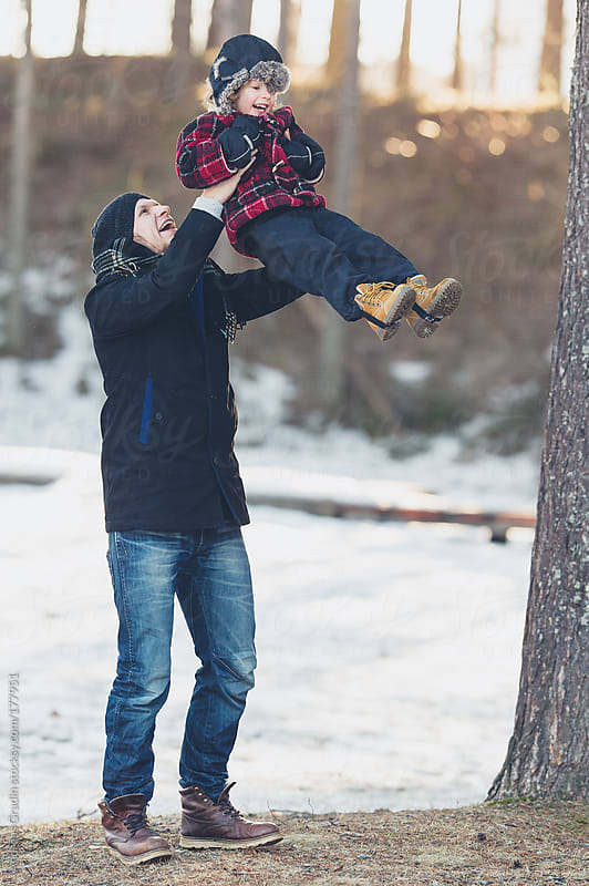 family fun in the swinter by Andreas Gradin for Stocksy United