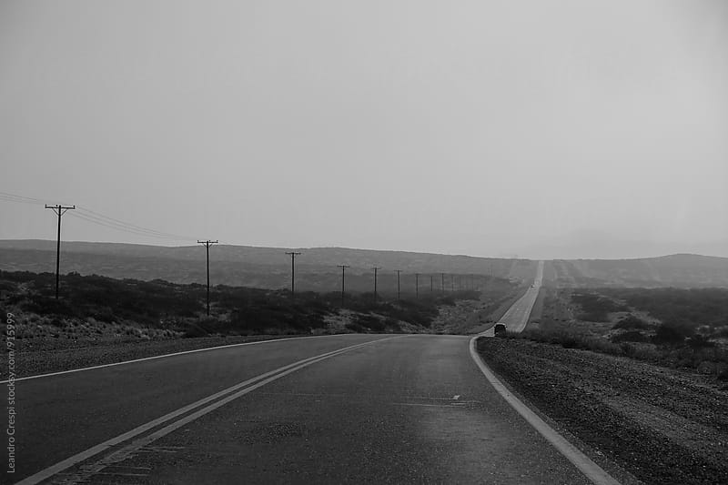 Landscape road scene in black and white, South of Argentina by Leandro Crespi for Stocksy United
