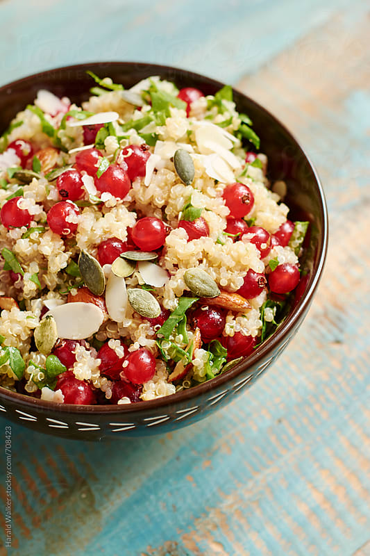 Quinoa, red currant salad with pumpkin seeds by Harald Walker for Stocksy United