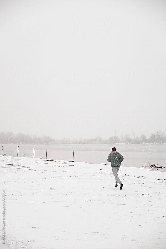 Back view of runner jogging at riverside by Danil Nevsky for Stocksy United