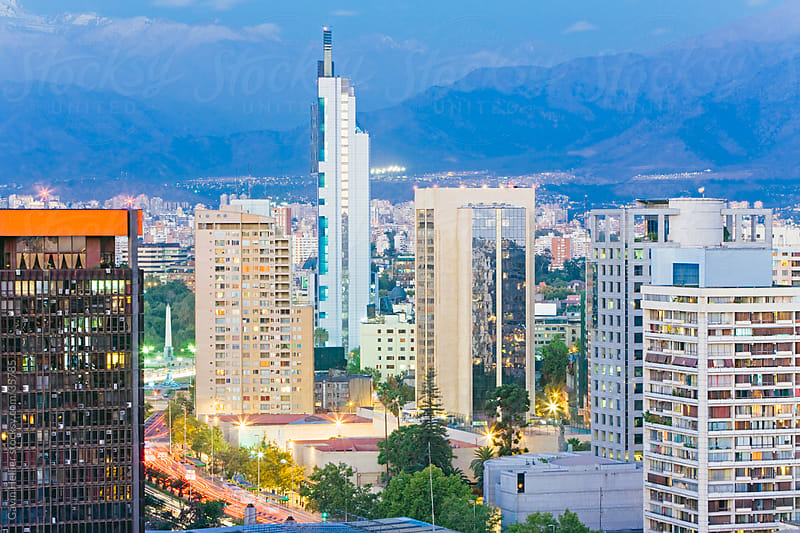 South America, Chile, Santiago city skyline and the Andes mountains at dusk by Gavin Hellier for Stocksy United