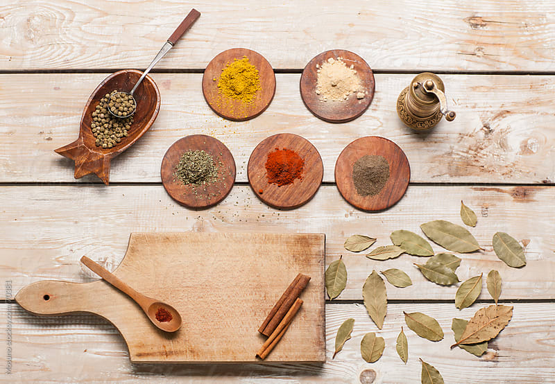 Different Spices on a Wooden Table by Mosuno for Stocksy United
