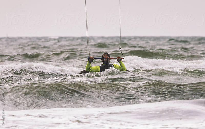 Kite surfer practising with his kite on the beach by Soren Egeberg for Stocksy United