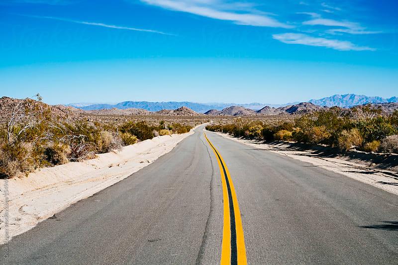 Beautiful road in a desert by Oscar Lopez for Stocksy United