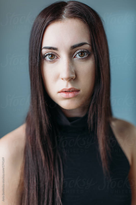 Studio portrait of a beatiful girl with long hair by Ania Boniecka for Stocksy United