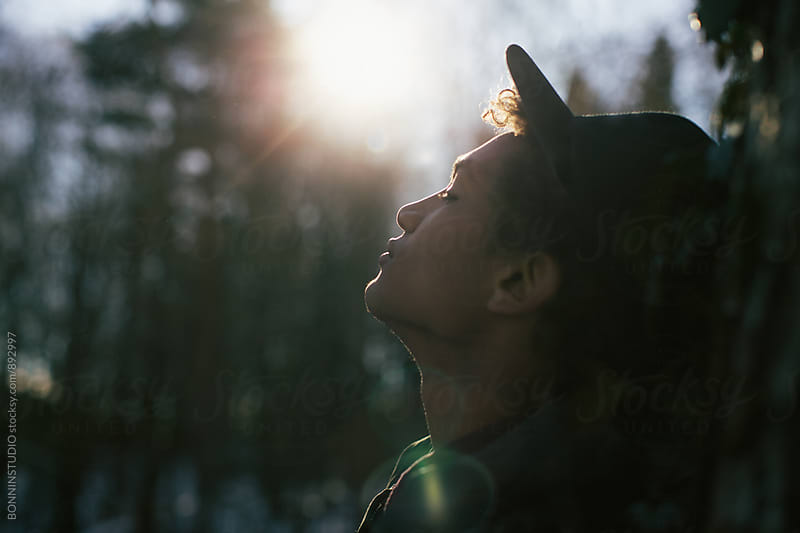 Side view of a man in the woods enjoying a sunny winter day. by BONNINSTUDIO for Stocksy United