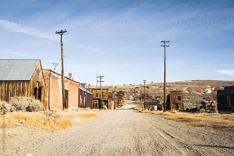 Road Through Creepy Ghost Town  by MEGHAN PINSONNEAULT for Stocksy United