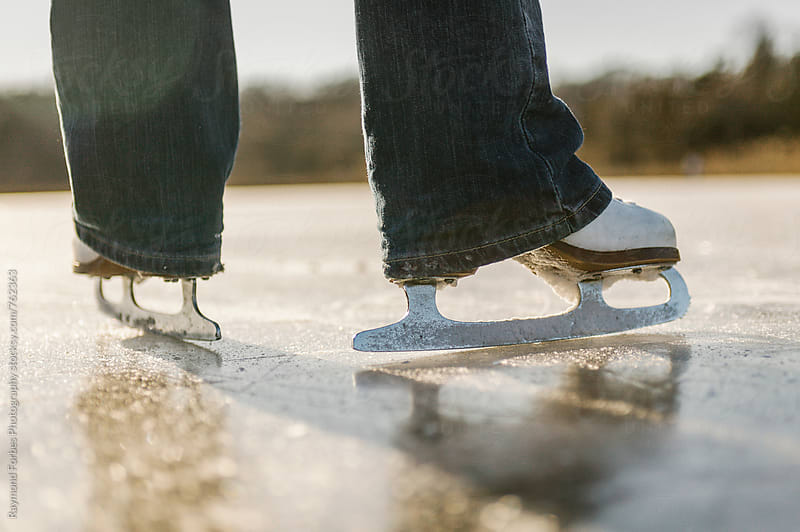 Ice Skating on Pond by Raymond Forbes LLC for Stocksy United