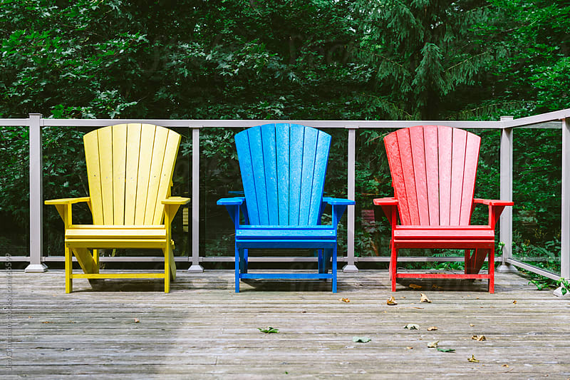 Adirondack chairs outside on the deck. by Jen Grantham for Stocksy United