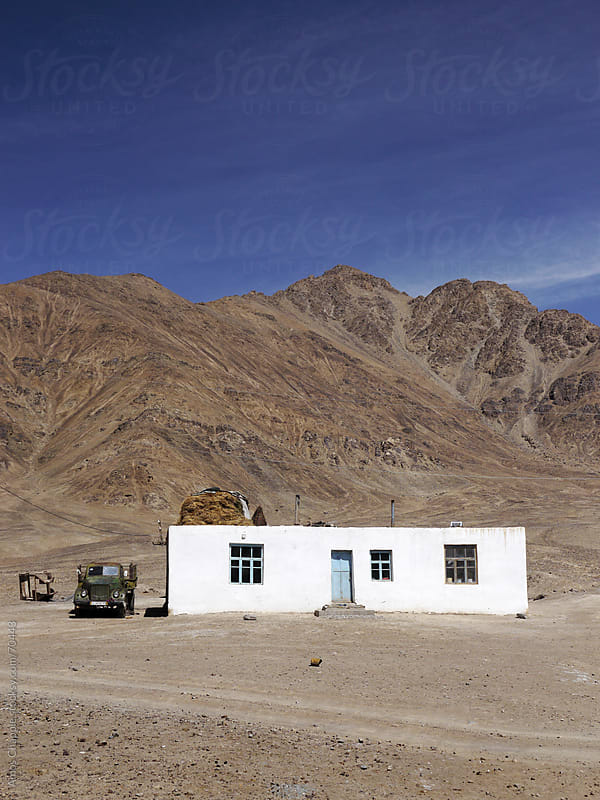 A simple white house in the highlands of Tajikistan.  by Amos Chapple for Stocksy United