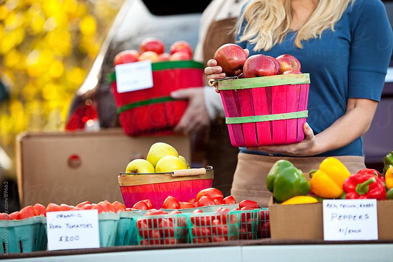 Farmer's Market: Holding a Basket of Apples by Sean Locke for Stocksy United