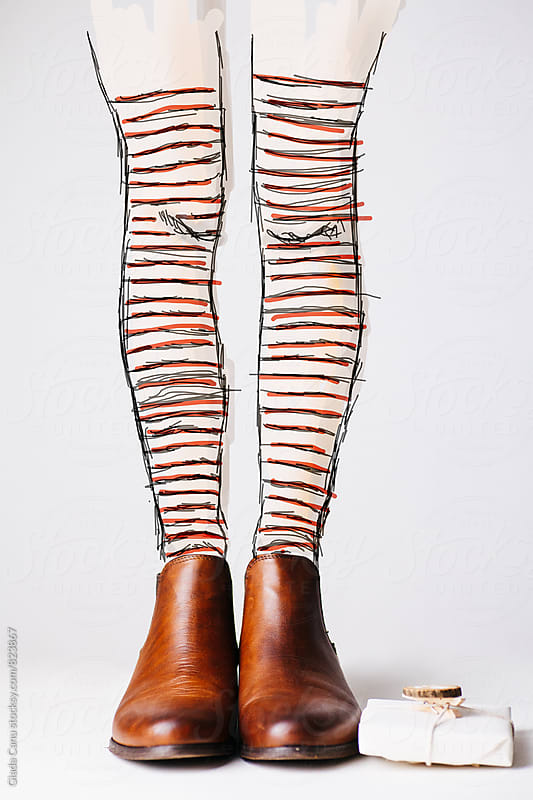 Leather shoes with a christmas present and legs drawed digitally  by Giada Canu for Stocksy United