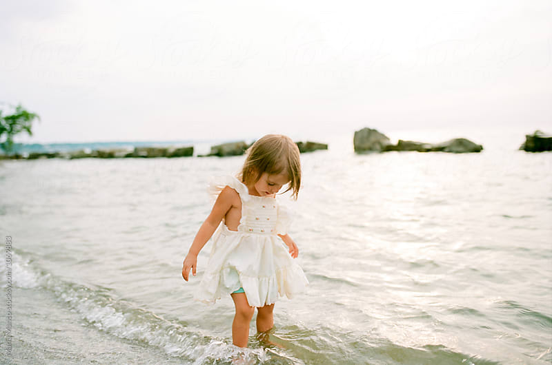 little girl on beach by Maria Manco for Stocksy United