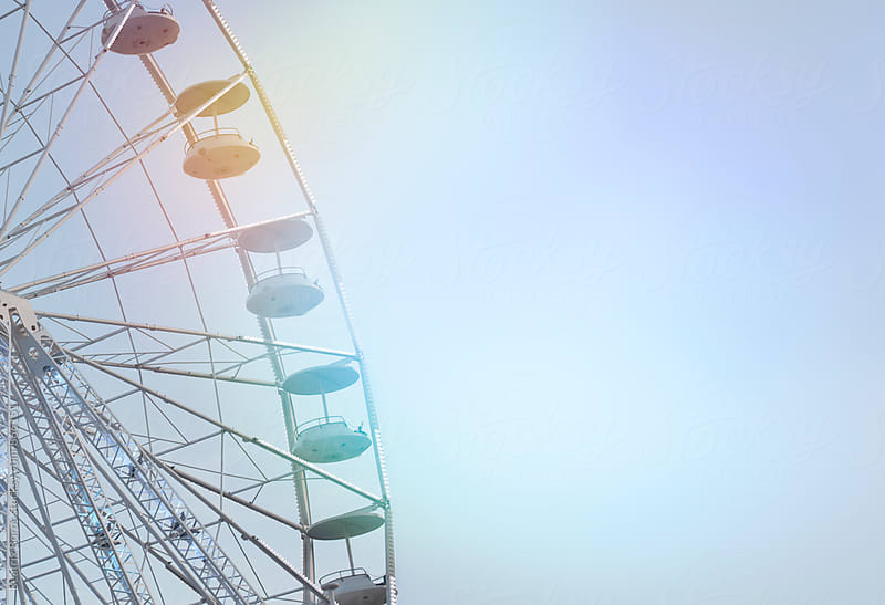 Double exposure of a quarter of a ferris wheel and colorful reflection by Beatrix Boros for Stocksy United