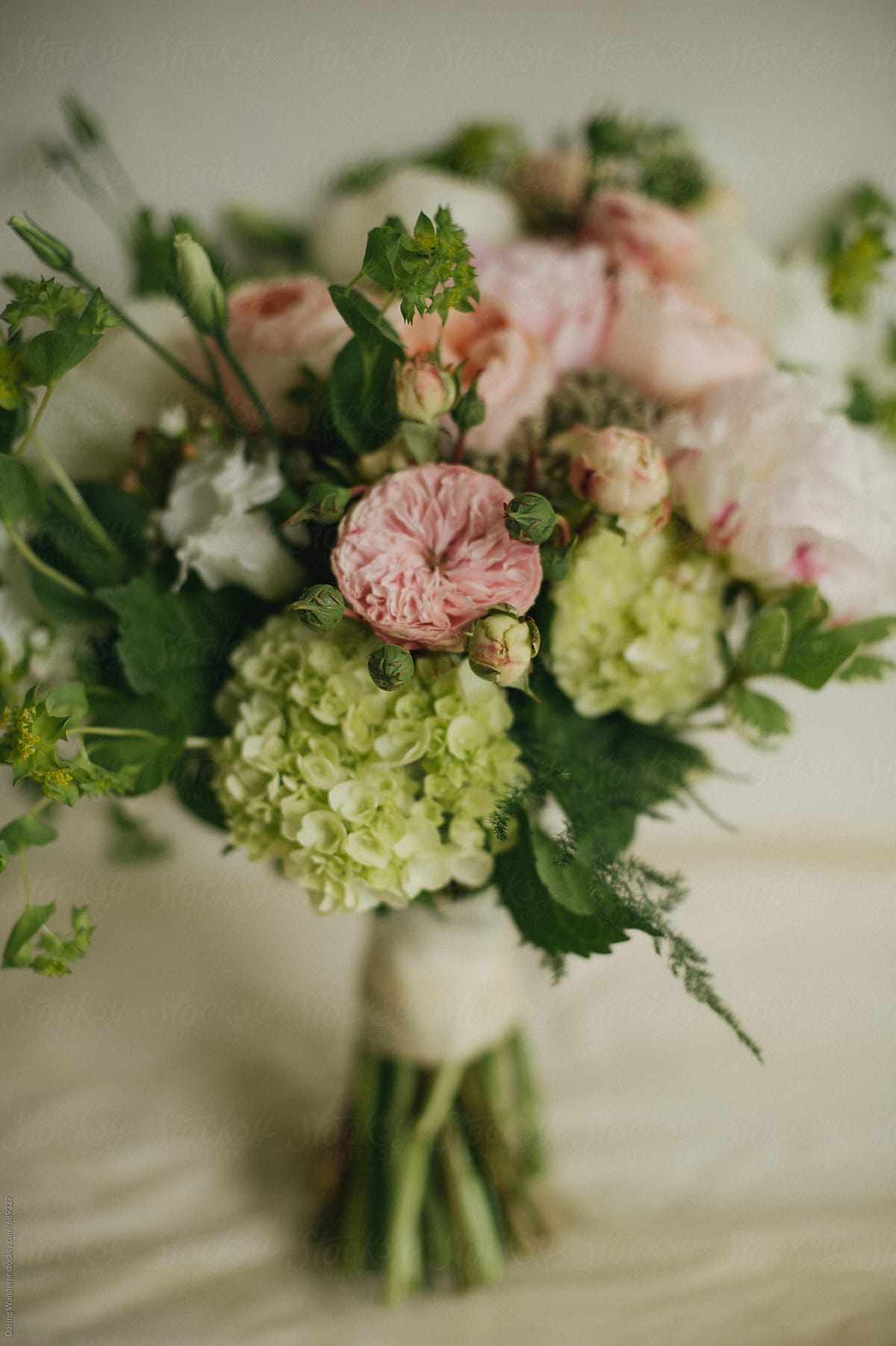 Handmade Blush Pink Garden Rose And Peonies Wedding Bouquet On Artist  Studio Table