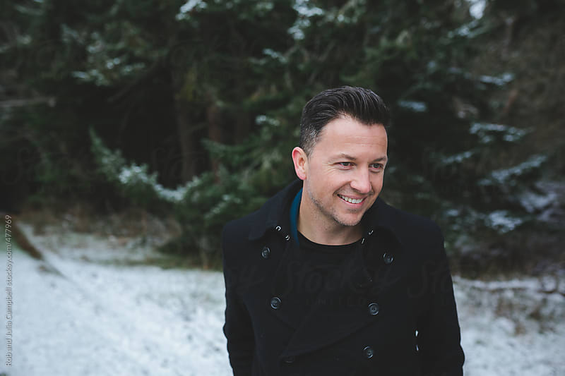 Portrait of happy, content, young middle aged man outside in winter by Rob and Julia Campbell for Stocksy United