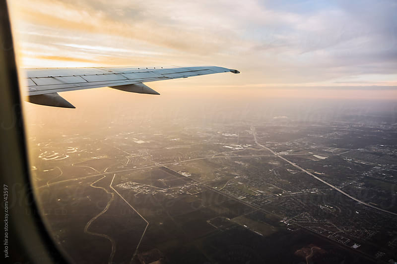 Window view from an airplane above Houston  by yuko hirao for Stocksy United