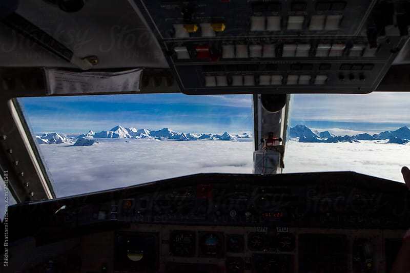 View from the cockpit of the aircraft flying in the mountains. by Shikhar Bhattarai for Stocksy United
