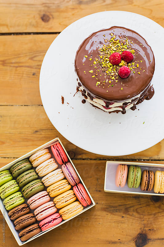 Chocolate mini cake and french macaroons by Jovana Rikalo for Stocksy United