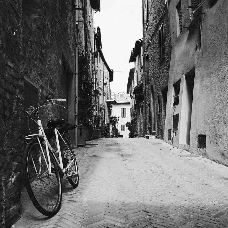 A bicycle on a narrow street in Italy in black and white by Greg Schmigel for Stocksy United