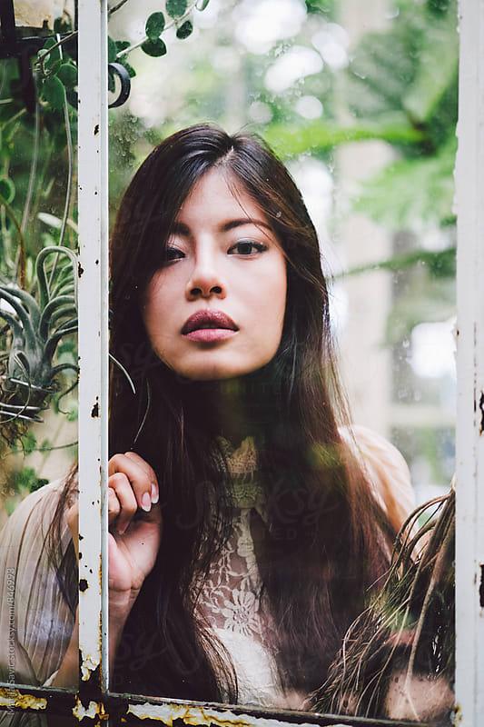 Beautiful Asian Woman in a Tropical Garden by Marija Savic for Stocksy United