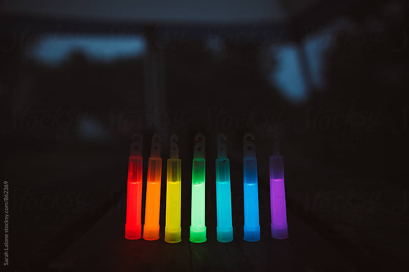 A rainbow of glow sticks  by Sarah Lalone for Stocksy United