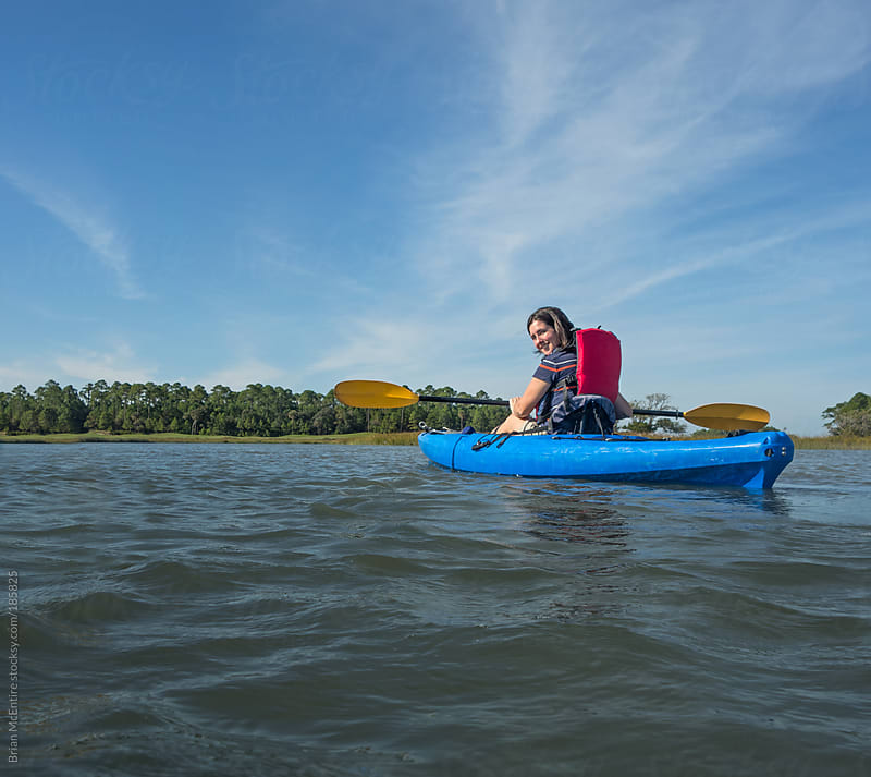 Family Kayaking Trip in Carolina Low Country by Brian McEntire for Stocksy United