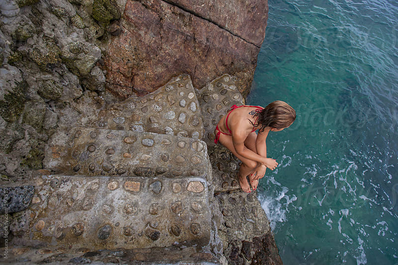 Woman Sitting on a Cliff by Mosuno for Stocksy United
