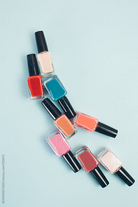 Pastel colored nail polish bottles from above. by BONNINSTUDIO for Stocksy United