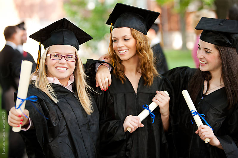 Graduation: Cute Graduate Smiles at Camera with Diploma by Sean Locke for Stocksy United