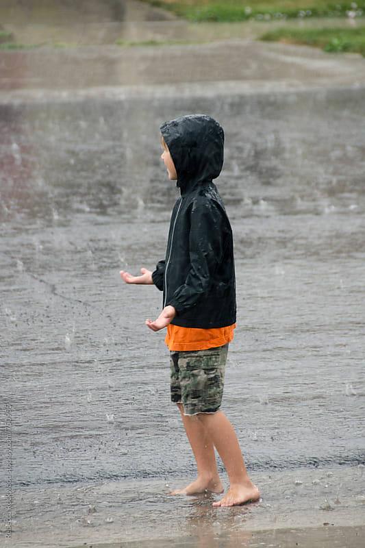 Little boy in the Rain by Rebecca Rockwood for Stocksy United