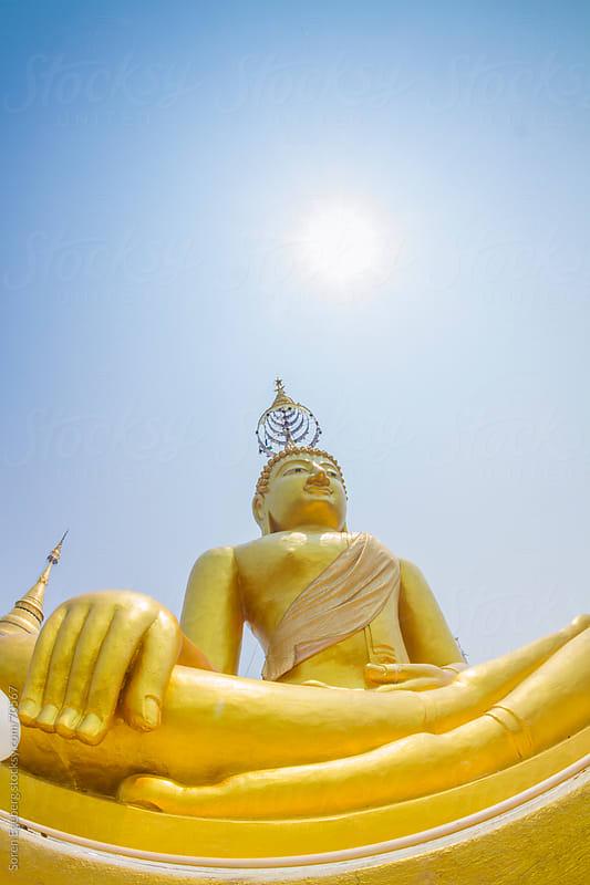 Golden Buddha statue in Thai temple by Soren Egeberg for Stocksy United