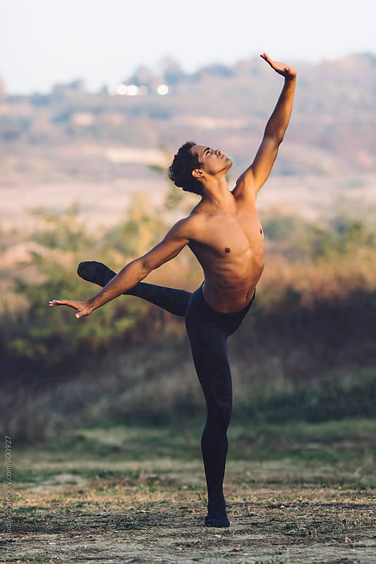 Ballet dancer dance in nature at sunset by Igor Madjinca for Stocksy United