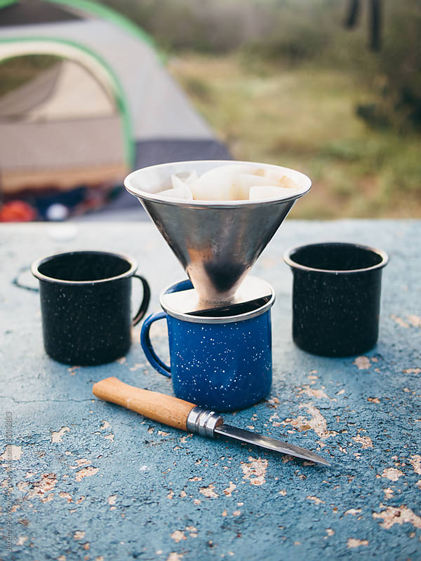 Making morning coffee at campground. by Jeremy Pawlowski for Stocksy United