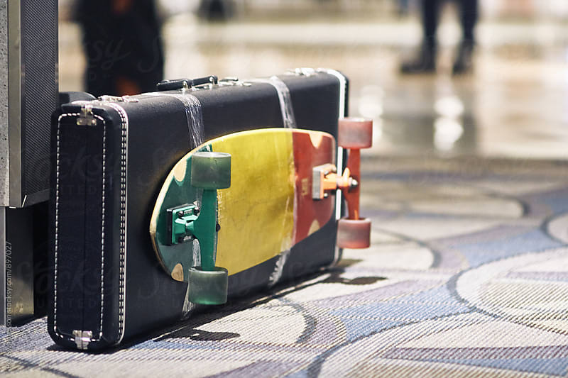 Traveler's guitar case with skate board by Per Swantesson for Stocksy United